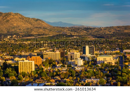Evening light on on distant mountains and the city of Riverside, from Mount Rubidoux Park, in Riverside, California. - stock photo