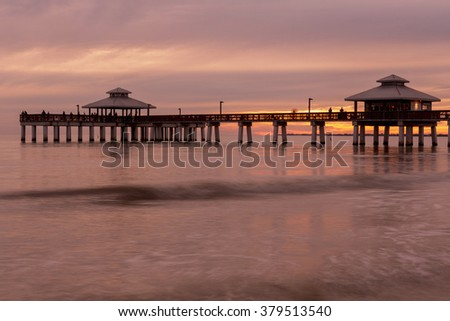 Evening light on the fishing pier in Fort Myers Beach, Gulf of Mexico Coast, Florida. - stock photo