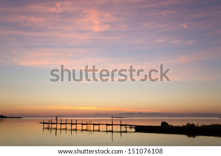 Evening light over bath pier at the coast of Oland in Sweden