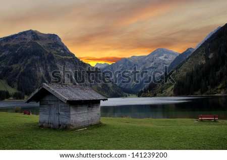 Evening mood at a mountain lake in the Tannheim mountains inTyrol, Austria; idyllic location/ Evening mood in the mountains
