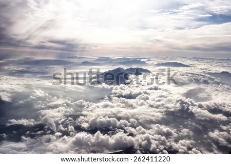 Evening Mountains and sunlight clouds. - stock photo