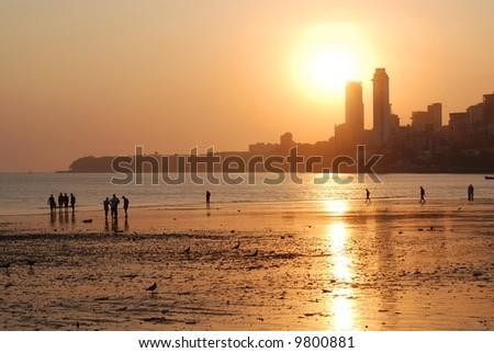 Evening Mumbai, Chowpatty beach. View of Malabar hill at sunset - stock photo