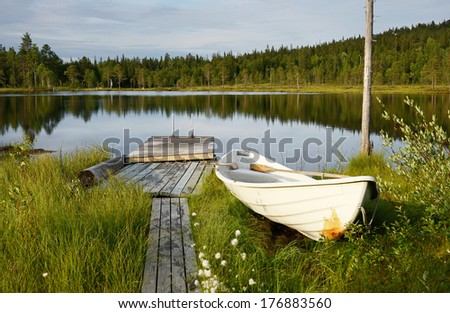 Evening on a blue lake. Northern Finland, Lapland - stock photo