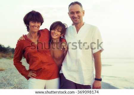Evening on the Azov Sea. Happy family on the beach. Toned image.