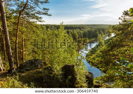 evening on the Ural river with rocky shore, Russia - stock photo