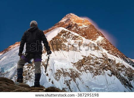Evening or night view of Mount Everest with climber from mount Pumo Ri base camp - Sagarmatha national park, Khumbu valley, Nepal