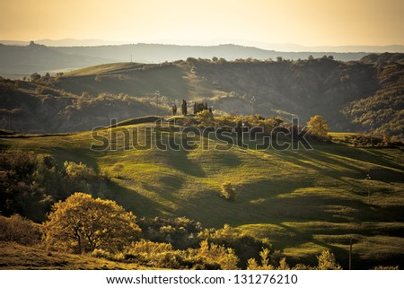 Evening Outdoor Tuscan hills landscape with great light. Horizontal toned shot