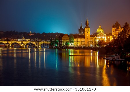 Evening over river Vltava near Charles bridge in Prague, Czech republic