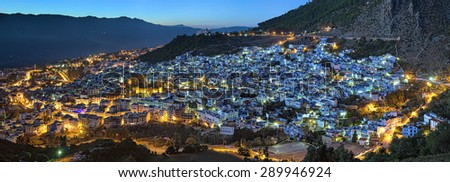 Evening panorama of Chefchaouen with buildings painted in blue color from the hill of Jemaa Bouzafar Mosque, Morocco - stock photo