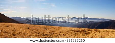 Evening panorama of mountains - stock photo