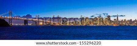 Evening panorama of San Francisco and Bay Bridge taken from Treasure Island. - stock photo