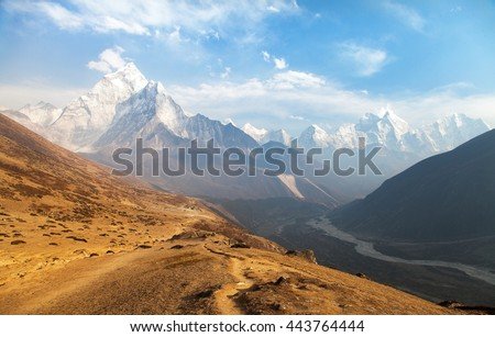 Evening panoramic view of mount Ama Dablam with beautiful sky on the way to Everest base camp, Khumbu valley, Sagarmatha national park, Everest area, Nepal - stock photo
