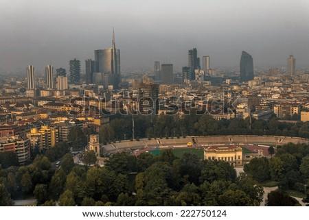 Evening photo of the Milan panorama with Roman buildings, stadium and skyscrapers - stock photo