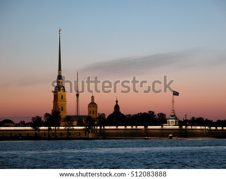 Evening photo of the spire of Peter and Paul Cathedral photographed after sunset.