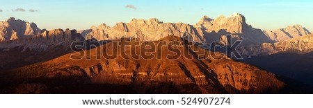 Evening red colored panoramic view of Gruppo di Tofana or Tofane Grupe, alps dolomites mountains, Italy
