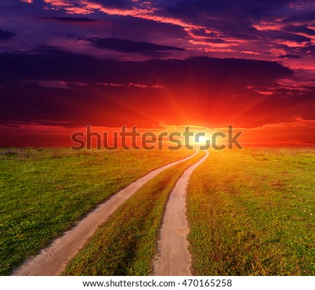 evening scene with dirt road to sunset
