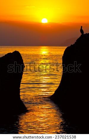 Evening scene with sunset on sea  - stock photo