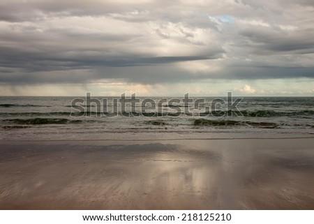 evening seascape, surf beach, New Zealand  - stock photo