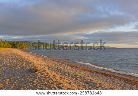 Evening Shadows on a Gravel Beach on Agawa Bay in Lake Superior Provincial Park in Ontario - stock photo