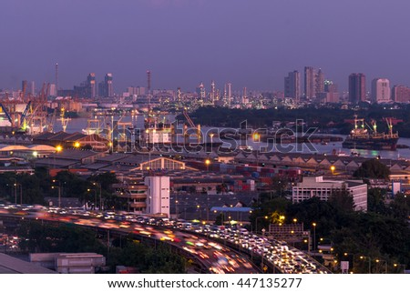 Evening sky to night time and Bangkok city and river with harbor