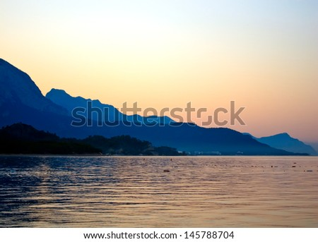 Evening skyline of Taurus mountains and lagoon in Kemer, Turkey - stock photo