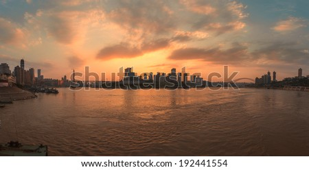 Evening skyline with skyscrapers, reflecting in the Yangtze river. Chongqing, China  - stock photo