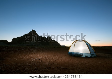 Evening Solitude (Camping on the Desert Lakeshore of Lake Powell in Arizona and Utah) - stock photo