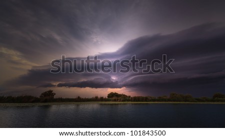 Evening storm over watershed and dramatic sky and clouds