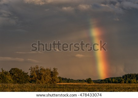 Evening Stormy Cloudy Blue Gray Sky. Use it As a Background. Rainbow in Background.