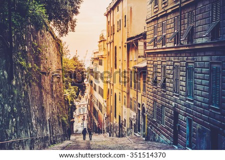 Evening street view in the old city of Genoa in Liguria region, Italy. Toned image - stock photo