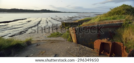 Evening Sun on Concrete Lighter barges beached at Purton to help prevent the River Severn erroding into the Gloucester Sharpness Canal - stock photo