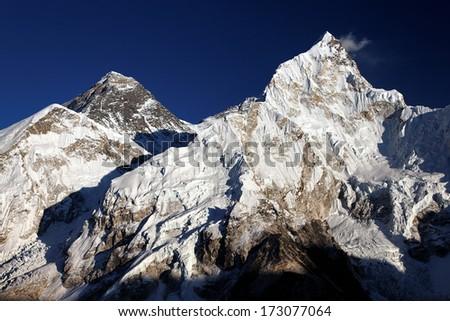 Evening sun on Mount Everest and Nuptse in the Nepal Himalaya - stock photo