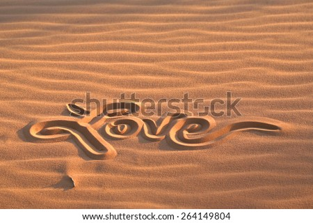 Evening sunset love message written in pink coral sand dunes Utah - stock photo