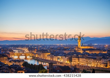 Evening sunset over florence with ponte vecchio bridge on arno river and tower in italy - stock photo