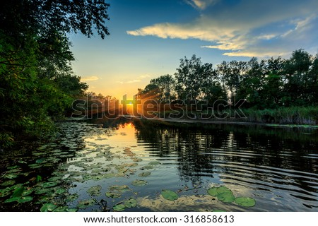 Evening sunset scene on river