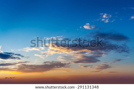 Evening sunset sky with dramatic clouds - stock photo