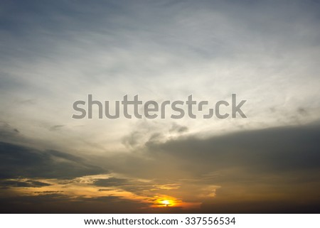 Evening sunset with cloudy skies - stock photo