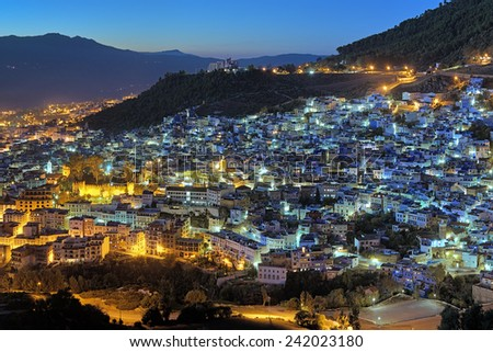Evening view of Chefchaouen from the hill of Jemaa Bouzafar Mosque, Morocco - stock photo