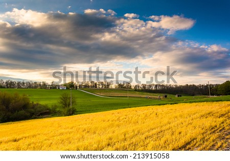 Evening view of farm fields and rolling hills in rural York County, Pennsylvania.