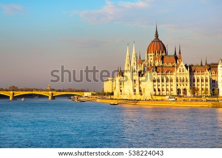 Evening view of hungarian Parliament building, Danube and bridge at sunset, Budapest, Hungary