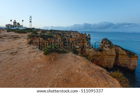 Evening view of lighthouse on cliff (Ponta da Piedade headland, Lagos, Algarve, Portugal).