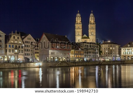 Evening. View of Limmat river with Grossmunster church in Zurich, Switzerland - stock photo
