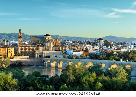 evening view of Mosque-Cathedral and Romano Bridge, Cordoba,Spain - stock photo