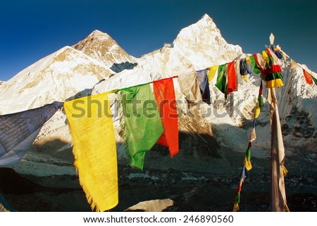 evening view of Mount Everest with buddhist prayer flags from Kala Patthar, way to Everest base camp, Nepal - stock photo