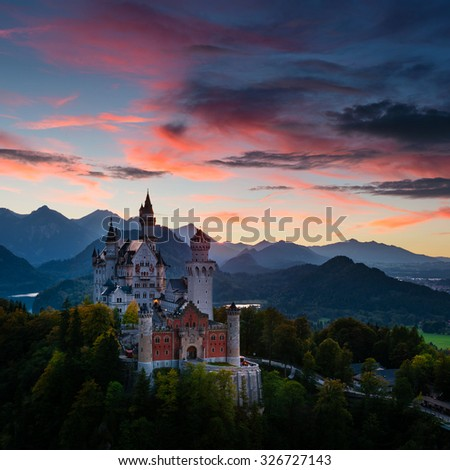 Evening view of Neuschwanstein Castle in Bavaria (Germany) with beautiful sunset sky