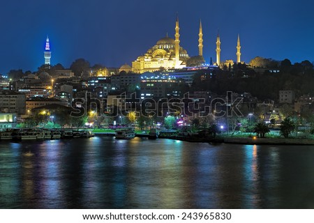 Evening view of Suleymaniye Mosque and Beyazit Tower (also named Seraskier Tower) from Golden Horn in Istanbul, Turkey - stock photo