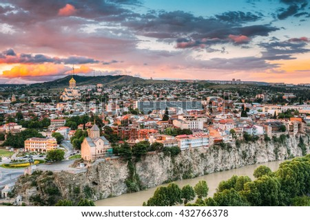 Evening View Of Tbilisi At Colorful Sunset, Georgia. Summer Cityscape. On Photograph Visible Holy Trinity Cathedral Of Tbilisi, Metekhi Church - stock photo