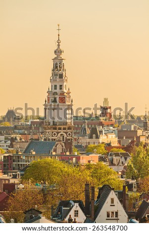 Evening view of the Amsterdam city center with the famous Zuiderkerk church located on the right - stock photo
