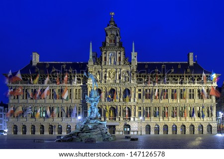 Evening view of the City Hall and Brabo fountain on the Great Market Square of Antwerp, Belgium - stock photo