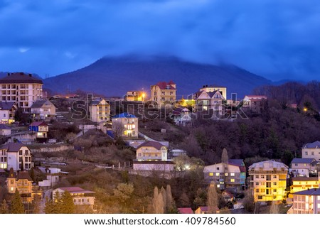 Evening view of the houses and mount Akhun. Sochi. Russia